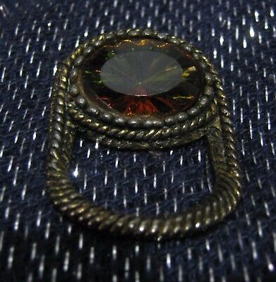 Wonderful bronze tone metal brooch with oval faceted orange brown stone