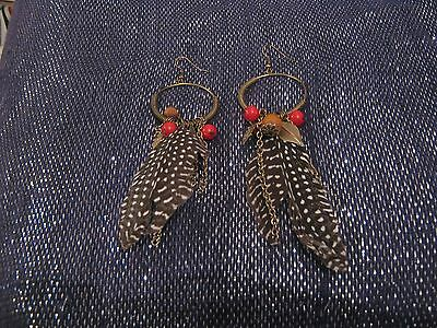 Wonderful bronze tone metal dangle earrings with beads charms & feathers