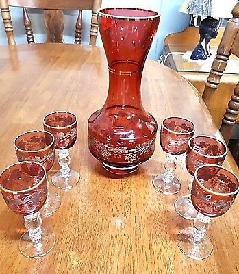 Ruby Glass Caraffe and 6 goblets