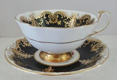 Vintage Paragon Black Gold And Flowers Tea Cup And Saucer