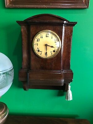 antique clock for repair - Gilbert Mantle with later wall bracket - can post
