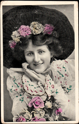 Vintage Tinsel Postcard of Young Lady posing with flowers