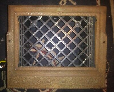 Antique cast iron heat vent grate frame made by Ideal. Victorian design.