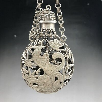 A phoenix image of a silver snuff bottle carved by hand in ancient Tibet