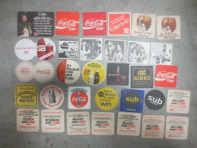 32 different COKE COLA Advertising  Issue collectable COASTERS