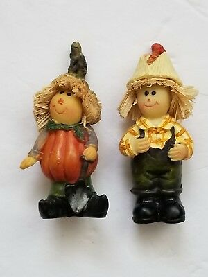 Pair of Scarecrow Figurines Pumpkin Body and Corn Hat