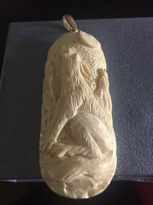 Carved Bone Wolf Pendent