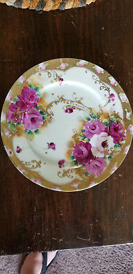 Nippon? Hand Painted plate with Roses in light to dark pinks heavily Gold gilded