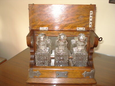 A Miniature Tantalus, Oak With Plated Mounts On Each Corner With Key