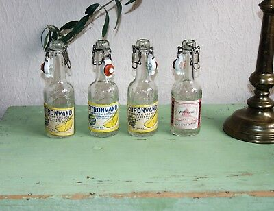 4 OLD SODA BOTTLES WITH PORCELAIN STOPPER AND ORIGINAL LABELS 1920s
