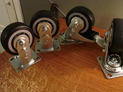 """Set of Four Casters Marked """"K"""" 5"""" Wheels 6-3/4"""" Tall With Zerk Fittings & Brake"""