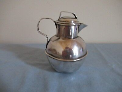 A Victorian sterling silver Guernsey creamer & cover
