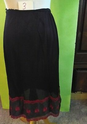 "Vintage Half Slip Black With 6"" red Lace . Measurements wast 10"" length"