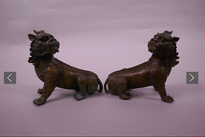 A small pair of Chinese Ming Dynasty bronze figures of Buddhist lions