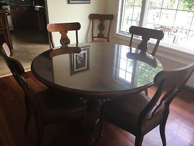 ethan allen dining room set with 6 chairs, leaf and table pads- no glass