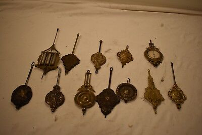 Box Lot 6. 12 Pendulums With A Very Expensive Compensated And An American Eagle