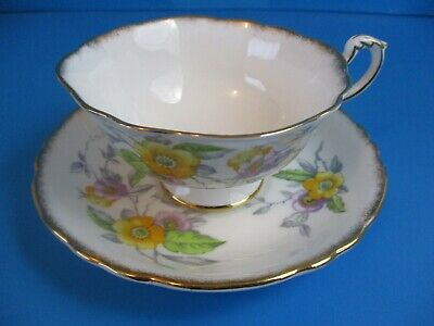 paragon cup saucer WHITE WITH YELLOW FLOWERS  SUPERB CONDITION  DOUBLE WARRANT