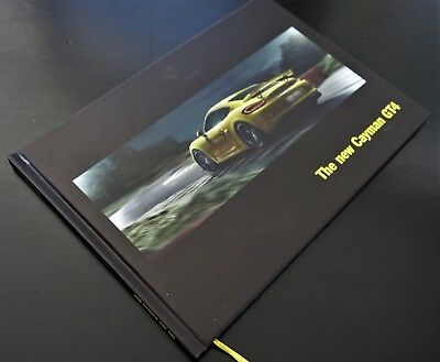 """New Porsche Cayman GT4 """"Rebels, race on"""" 1st Edition Hard Cover, 64 pages, rare"""