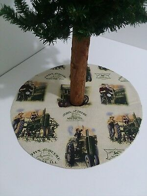 A JOHN DEERE table top tree skirt that is 16.5