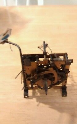 One Cuckoo Clock Works ( Movement) with bird.  Parts or Repair