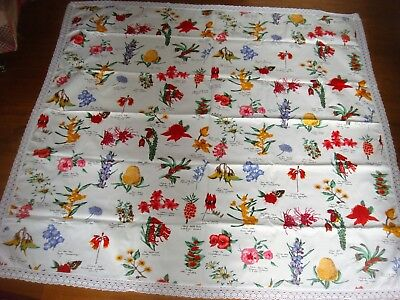 Beautiful bright lace edge vintage cloth with exotic flowers and napkins