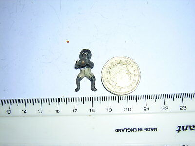Unusual Miniature cold painted bronze negro person holding a ball?