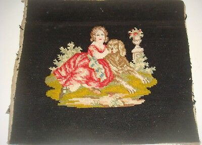 Antique needlework of a girl with a dog