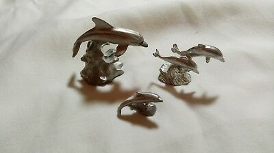 Pewter Dolphin Figurines, set of 3 dolphins figurines leaping over waves