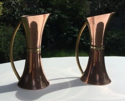 A Pair Of Stylish Arts & Crafts Copper And Brass Jugs