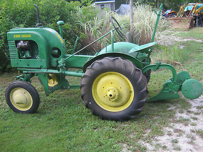 John Deere L LA tractor new rear tires runs and works use for parts or restore