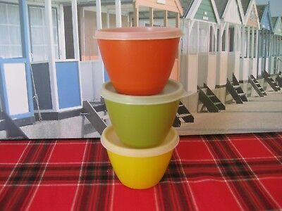 Tupperware Three Round Containers with lids . (2)