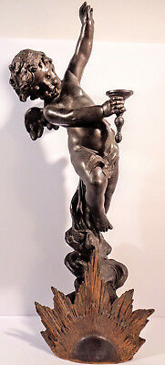 "Large antique bronze figure of Cupid with gilt sunburst. French, 19th c. 20"" H."