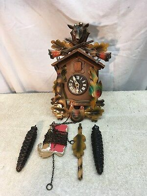 Vintage West German  v hunter type 8 day cuckoo clock with guns and Deer