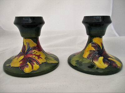 Pair of Walter Moorcroft Hibiscus Candle Holders on Green Ground with Blue Rim