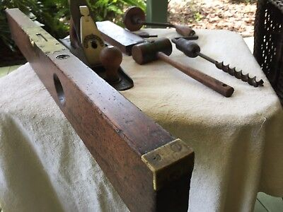 antique woodworking tool collection including very old rare level