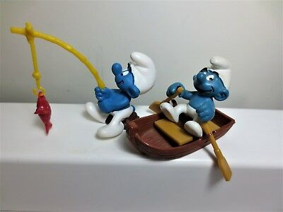 2 super smurf in new condition but no boxes  uncommon now # 165