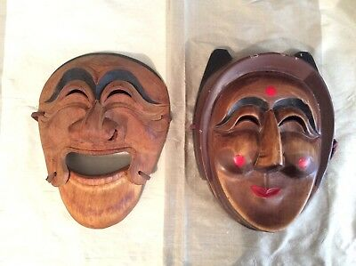 A pair of vintage carved & painted wooden Korean masks, one with articulated jaw