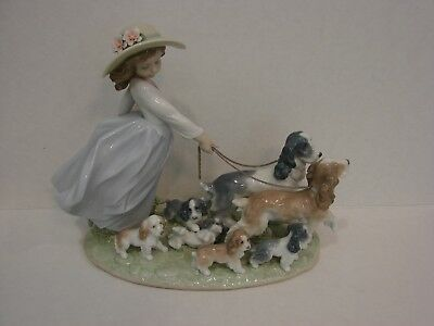 """Lladro  Privilege  """"Puppy Parade"""" Girl with Dogs Figurine, #6784"""