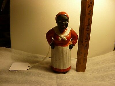 """VINTAGE CAST IRON BLACK AMERICAN Coin Bank 5"""" tall and 2"""" wide"""