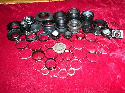 "A Large Selection Of Small 1/2"" To 1""  Glass Lenses From Camera Lenses"