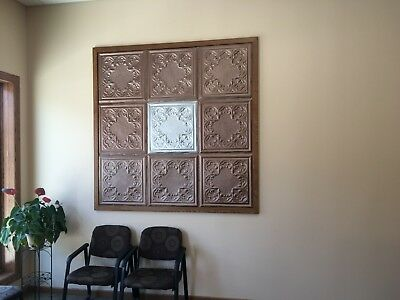 stamped tin ceiling tile (2x2). I have 2 styles with over 100 of each. Excellent