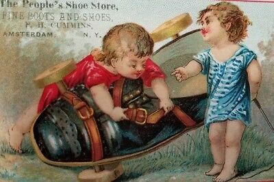Victorian Trade Card The People's Shoe Store Amsterdam,N.Y.Boy Girl Giant Cart