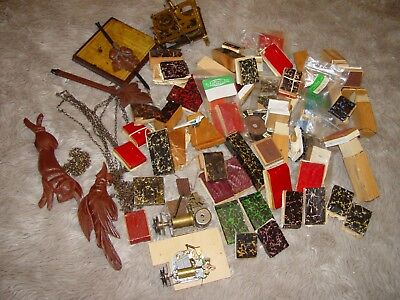 Lot of misc cuckoo clock parts music boxes, chains, pendulums, bellows, tubes..e