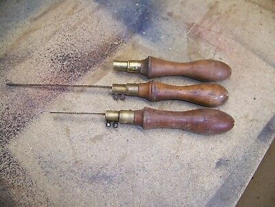 3 nice old brass and wood padsaw handles, two with blades