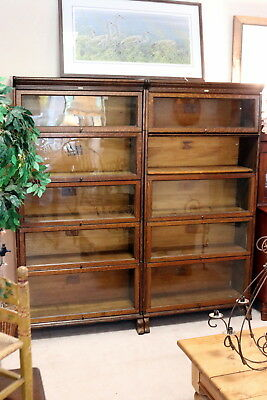2 matching Lindstrom  Oak Stacking Bookcases 5 sections each