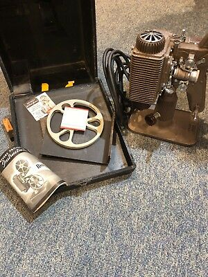Revere Eight 8 mm Projector with Case and extras.  Working