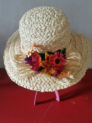 Vintage womens straw hat with floral decoration