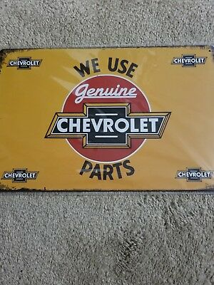 Chevrolet We Use Genuine Parts Bow Tie Metal Tin Sign U.S Seller