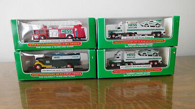 Collectible Miniature Hess Trucks ONE 1999, ONE 2000, AND TWO 2001 NEW IN BOX