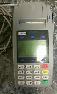 First Data FD50EMV NFC Dial/IP Credit Card Machine with rolls of thermal paper